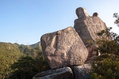 Amah Rock in Lion Rock country park, Hong Kong. LION ROCK COUNTRY PARK, HONG KONG - Amah Rock is a well-known natural rock located in Lion Rock country park stock photography