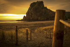 Lion rock piha. A moody sunset at south piha beach auckland nz Stock Photos