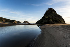 Lion Rock, Piha Beach. Shot from behind the famous lion rock looking to south piha and out to the ocean in a beautiful evening stock photo
