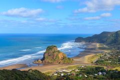 Lion Rock at Piha beach aerial view, New Zealand royalty free stock images