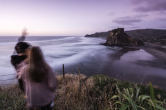 Lion Rock, Piha, NZ. Iconic Lion Rock at Piha Beach, Auckland, NZ. Long exposure used to blur out the swell royalty free stock image
