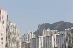 Lion Rock y Wong Tai Sin Estate en Hong Kong Imagen de archivo libre de regalías