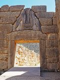 The Lion`s Gate, entrance to the ruins at the ancient city of Mycenae in Greece. The famous Lions Gate, entrance to the archaeological park at the ancient city Royalty Free Stock Photography