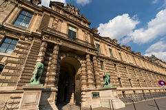 Lion's gate of Louvre Museum in Paris Stock Photo