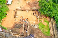 The Lion`s Gate from the top. SIGIRIYA, SRI LANKA - NOVEMBER 27, 2016: The Lion`s Gate and the Middle Terrace of Sigiriya Fortress from the top of the Rock, on Royalty Free Stock Image