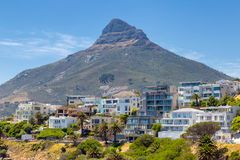 Lion`s head mountain and apartment buildings on the coast of Cape Town. South Africa royalty free stock photos