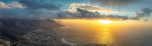 Lion`s head top panoramic view of Table Mountain and Cape Town city at sunset royalty free stock image
