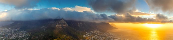 Lion`s head top panoramic view of Table Mountain and Cape Town city at sunset. With beatiful clouds in the sky royalty free stock photos