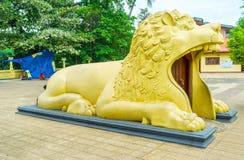The lion`s jaws. PERADENIYA, SRI LANKA - NOVEMBER 28, 2016: The building in Gatambe Sri Rajopawanaramaya Temple in form of the lion with the door in his open Royalty Free Stock Photography