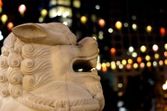 Lion's Roar. Lion with bokeh that makes it look like flames. Entrance of China Town Boston royalty free stock image