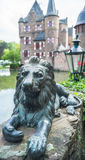 Lion's sculpture next to the Satzvey castle. Satzvey, Germany - May 19, 2013: Lion's sculpture as a symbol of protection next to the Satzvey castle Stock Images