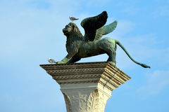 Lion of Saint Mark on a column in Venice - Italy. Stock Image