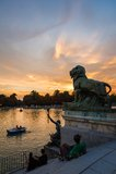 Lion sculpture in Buen Retiro park lake, Madrid royalty free stock photos