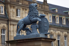 Lion sculpture with crest in front of the main entrance of the New Castle Neues Schloss in Germany, Stuttgart Royalty Free Stock Images