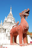 Lion sculpture in front of Phra That Hariphunchai Worramahawihan Stock Photos