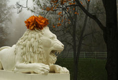 Lion sculpture with garland Stock Image