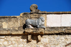 Lion sculpture on Giants Arch, Antequera. Stock Photos