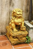 Lion sculpture. Golden lion sculpture temple in Asia Royalty Free Stock Image