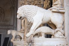 The lion sculpture near entry to Cathedral of St. Lawrence in Trogir city. Trogir is a historic town in Croatia on the Adriatic coast. Its historical center is stock photo