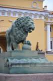 Lion sculpture near the Palace bridge in St. Petersburg Royalty Free Stock Photography