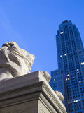 Lion Sculpture and Skyscraper at Night Royalty Free Stock Photo