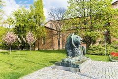 Lion sculpture in Sofia,Bulgaria. Big lion statue in front of the saint Sofia church in the spring royalty free stock photography