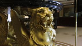 Lion sculpture statue. Luxury gold table interior design stock video