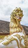 Lion sculpture in Thai Temple with white sky Stock Photography