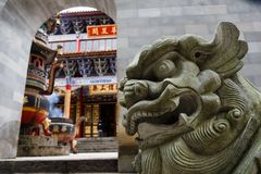 Lion sculpture in traditional Chinese Buddhist temple in Kunming city stock image