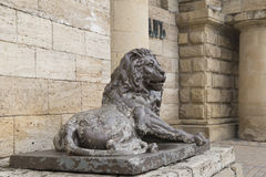 Lion sculpture before  tunnel to the underground lake Proval, Py Stock Photography