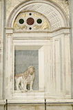 Lion Sculpture, Venice Hospital. Trompe L'oeil style sculpture of a lion in an archway.  Historic sculpture on the facade of the Scuola di San Marco which is now Royalty Free Stock Image