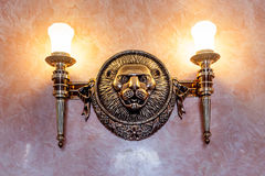 Lion sculpture vintage decoration on the wall Stock Photography