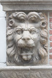 Lion sculpture on a wall Stock Photos