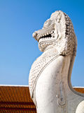 Lion sculpture of the Wat Benchamabophit. Antique guardian lion sculpture in front of the Wat Benchamabophit temple, Bangkok , Thailand Stock Images