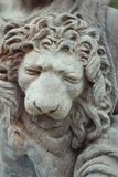 Lion sculptures spraying water on wall background Stock Photos