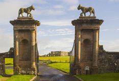Lion sculptures on top of the stone gate posts at the Bishop`s Gate entrance to Mussenden Hose in Northern Ireland stock images