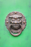 Lion-shaped door knocker on a green door in Beijing, China Royalty Free Stock Images