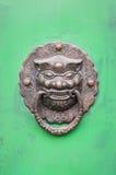 Lion-shaped door knocker on a green door in Beijing, China Royalty Free Stock Images