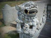 Lion-shaped stone statue of fire stock image