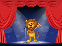 A lion singing at the center of the stage Royalty Free Stock Photos