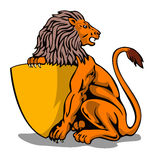 Lion sitting holding a shield Stock Photo