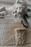 Lion and a snake in Grenoble Royalty Free Stock Photo