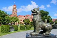 Lion stands proud guarding the statue. The downtown park in the center of yangon burma myanmar Stock Photos