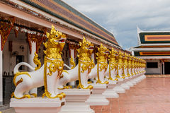 Lion statue in Asian style at phathat Cheung choom woravihan tem royalty free stock image