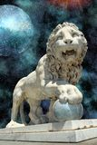 Lion statue with blue planet Stock Photos