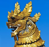Lion statue and Buddhist Temple Royalty Free Stock Photography