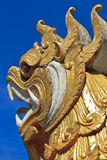 Lion statue and Buddhist Temple Stock Photo