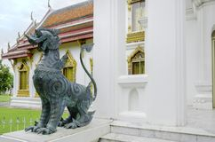 Lion statue in Buddhist temple / Lion statue. Green Lion statue in Buddhist temple / Lion statue Royalty Free Stock Photography