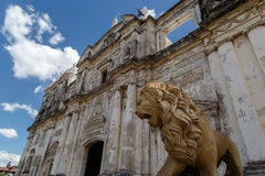 Lion statue with the cathedral of Leon in Nicaragua Royalty Free Stock Image