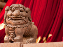 Lion statue in a chinese temple. Wooden lion statue in a chinese temple Royalty Free Stock Images